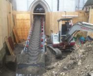 Convoyeur à bande Tecnitude pour travaux de décaissement intérieur dans une cathédrale américaine - Chantier BTP